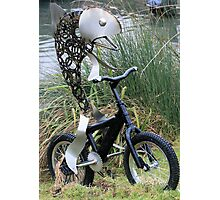 Fish on a bicycle sculpture Photographic Print