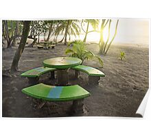 Sunset on beach with round table and benches Poster