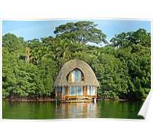 Tropical bungalow over water with thatched roof Poster