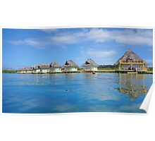 Tropical resort over water with thatched roof huts Poster