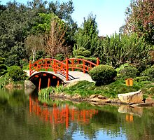 Bridge and reflection at the Japanese Gardens. by Marilyn Baldey
