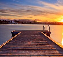 Sunset over the jetty by Delfino