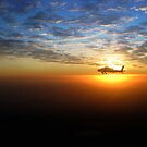 AH-64D at Sunrise Over Baghdad by Eduardo Alomar