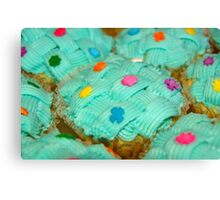 cupcake with green coating and sugar candies Canvas Print