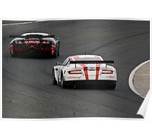 Aston Martin chases Lamborghini Poster