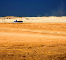 Blue truck through the Egyptian desert by MikeyLee