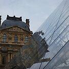 Le Louvre in Paris, France by Laura Cooper