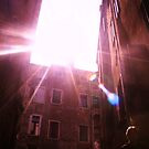 shot of light flare through buildings on a gondola in venise by xxnatbxx