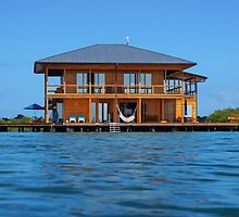Wooden tropical home over water of Caribbean sea by Dam - www.seaphotoart.com