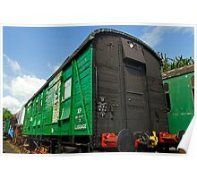 Green Luggage trailer in Railway sidings Poster