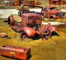 Ghost town at Bodie, CA rusty car and truck by jusclick