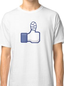 thumbs up, like, facebook, like it, bandage wrapped around an injured finger Classic T-Shirt