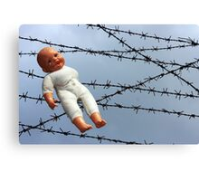 Baby doll and barbwire Canvas Print