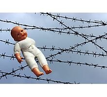 Baby doll and barbwire Photographic Print