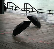 2 umbrellas on pier by orion plexus