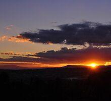 Brilliant Sunrise over mountains by Joel  Ridgeway