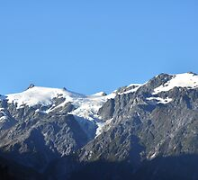 Snow capped mountains in Franz Josef New Zealand by mike99