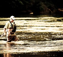 Fly fisherman by Mark Craig
