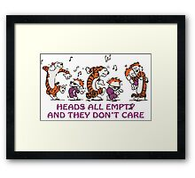 Heads all empty and they don't care! Framed Print