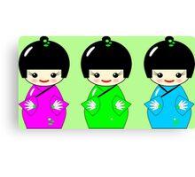 Cute Kokeshi dolls on green Canvas Print