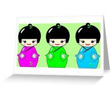 Cute Kokeshi dolls on green Greeting Card
