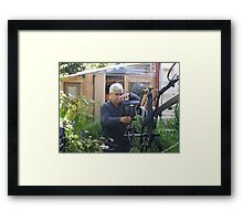 GENIUS AT WORK Framed Print