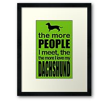 THE MORE PEOPLE I MEET, THE DACHSHUND Framed Print