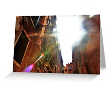 light flare through the buildings Greeting Card