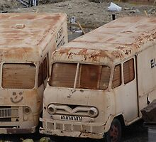 two old trucks find love. by Amanda Huggins