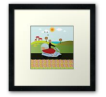 A woman riding a motorcycle Framed Print