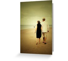 Couple walking down the beach Greeting Card