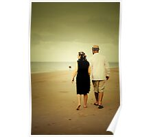 Couple walking down the beach Poster