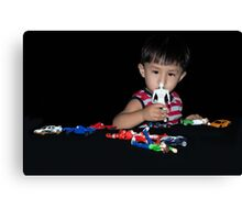 Ryan with his toys. Canvas Print