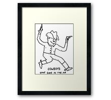 Cowboys shoot guns in the air Framed Print