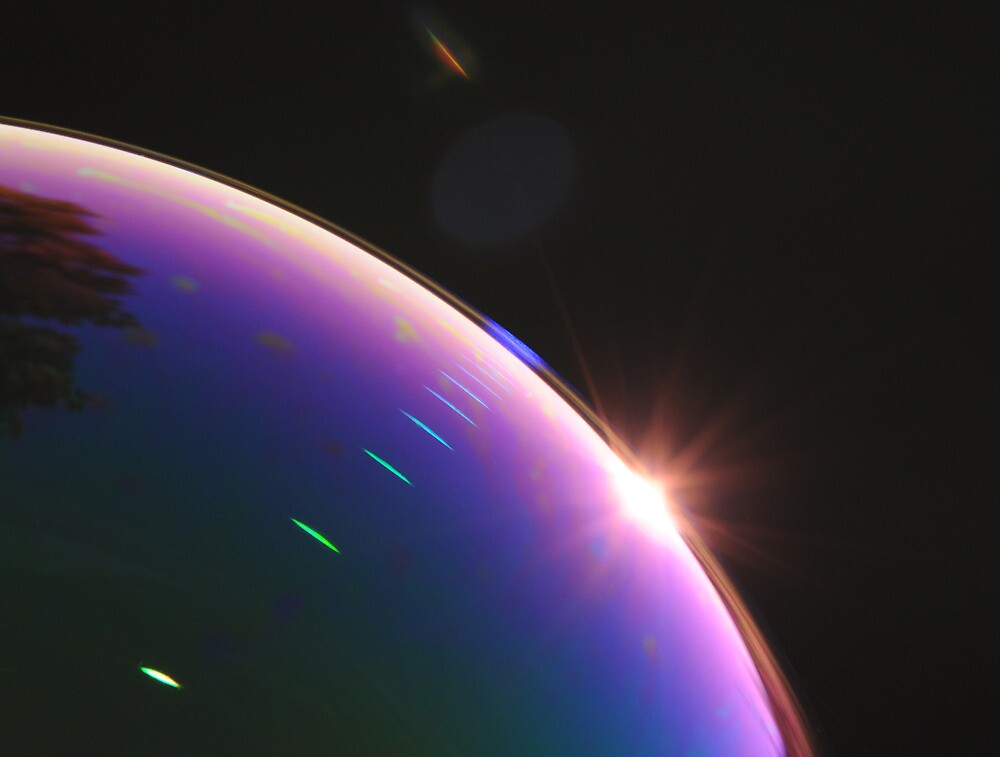 Solar Flares on Planet Soap Bubble by Richard Heeks