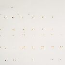 Old Adhesive Tape on White Wall by visualspectrum