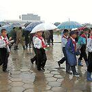 Getting into line in the rain by Marjolein Katsma