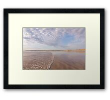 The tide washes in at Westward Ho! beach in North Devon, UK Framed Print