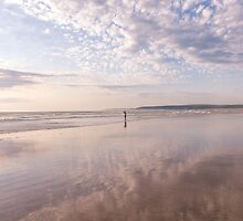 Reflections at Westward Ho! beach in North Devon, UK by Zoe Power