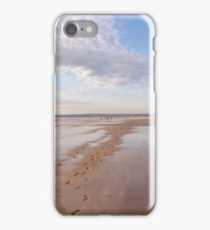 Footprints and reflections at Westward Ho! beach in North Devon, UK iPhone Case/Skin