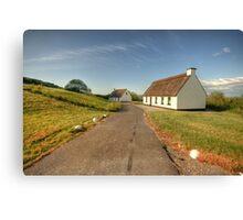 Thatched cottages Canvas Print