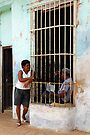 Couple chatting, Trinidad, Cuba by David Carton