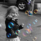 Girl playing with Bubbles by Hege Nolan