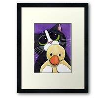 Scared Tuxedo Cat with Toy Duck Framed Print