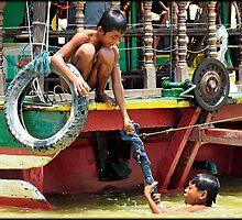 Washing Jeans Tonle Sap by Tim  Barnsley