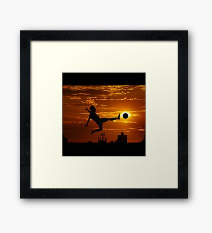 sports statue in city Framed Print