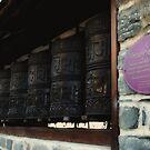 Tibetan Prayer Wheels by Laura Cooper