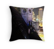A caped crusader watches over gotham Throw Pillow