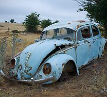 Old Volkswagon car on farm by Speedy