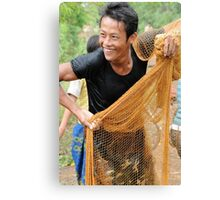 Teaching how to fish with a throw net Canvas Print